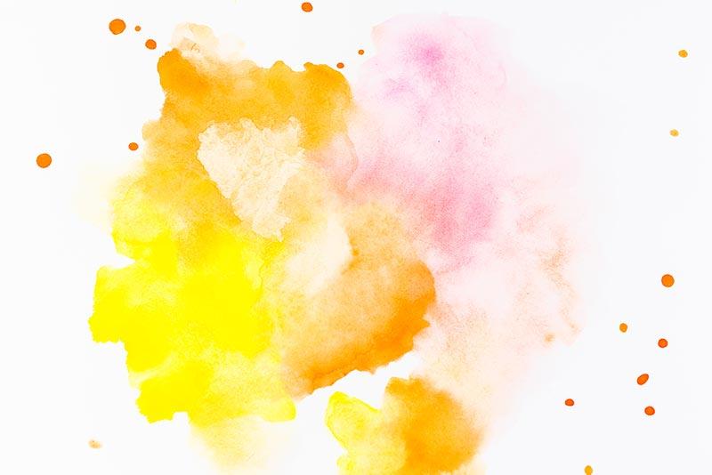 macchia di colore stra giallo, arancione e rosa